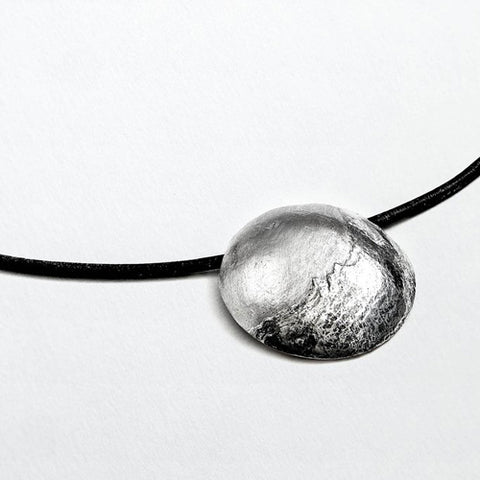 Mountain textured pendant and leather necklet in silver