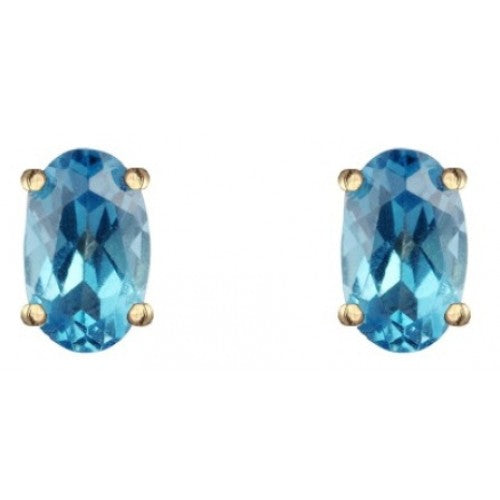 Blue topaz 6mm x 4mm oval stud earrings in 9ct gold