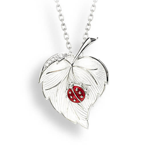 Ladybird on leaf pendant and chain with white sapphire in silver