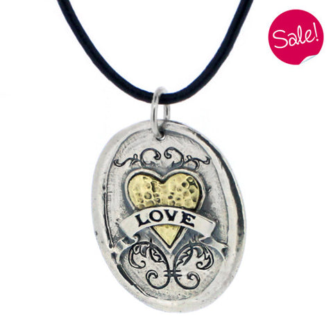 Large oval 'love' pendant and cord in silver and brass