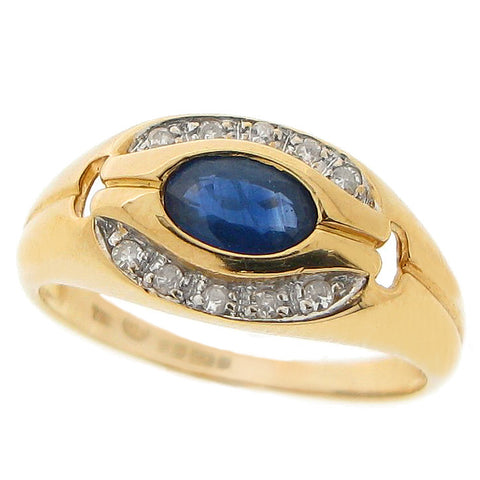 Sapphire and diamond cluster ring in 18ct gold