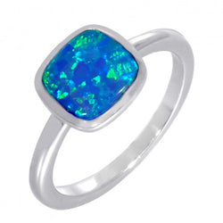 Blue simulated opal solitaire ring in silver