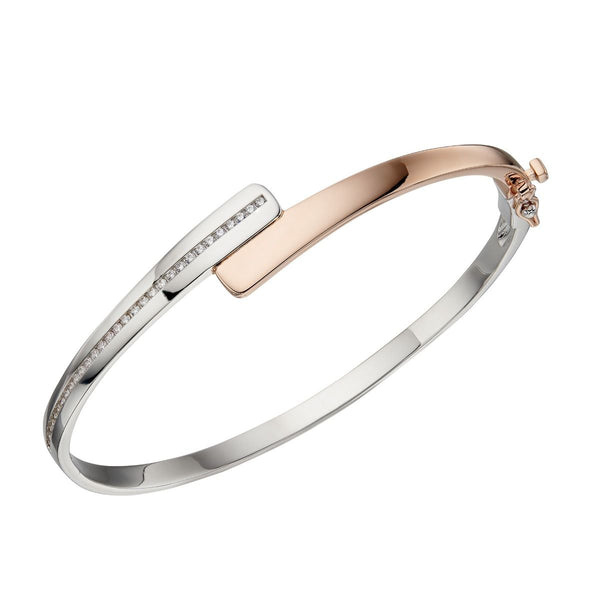 Cubic zirconia crossover hinged bangle in silver with rose gold plating