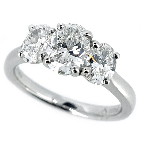 Oval diamond three stone ring in platinum, 1.70ct