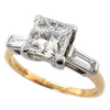 Princess and baguette cut diamond three stone ring in 18ct gold, 2.44ct