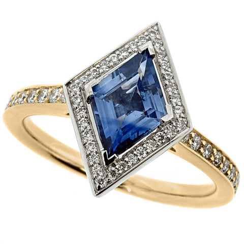 Sapphire and diamond kite-shaped halo cluster ring in 18ct gold and platinum
