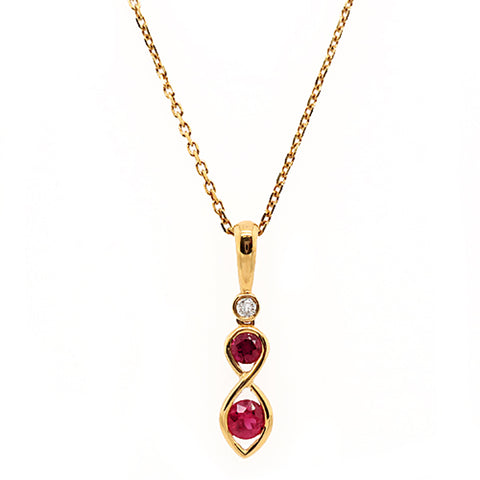 Ruby and diamond pendant and chain in 18ct gold
