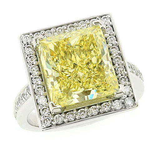 Rectangular princess cut natural yellow diamond and diamond halo cluster ring in platinum, 5.81ct