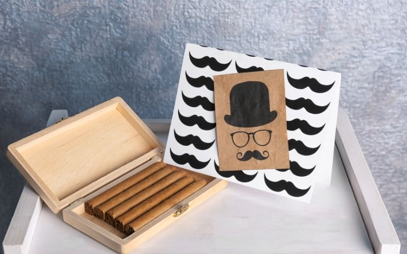 Humidor with Cigars and Card for Father's Day on Table