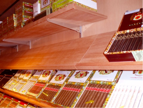 Shelves in a large walk-in humidor to show how to build a walk in humidor