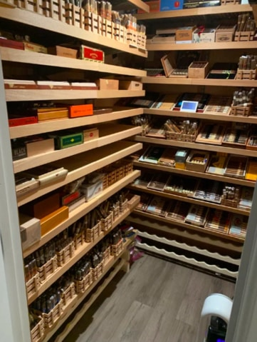 Two stacks of shelves in a large walk-in humidor to show how to build a walk in humidor