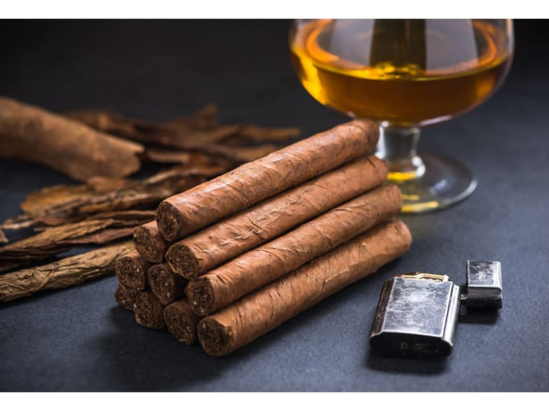 Stack of cigars with cognac