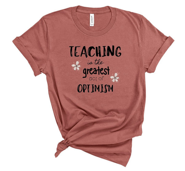 "T shirt by JETT IMPRESSIONS ""Teaching Greatest Act Optimism"" Teacher T shirts"