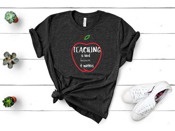 "T shirt by JETT IMPRESSIONS ""Teaching is Hard"" Teacher T shirts for Men or Women"