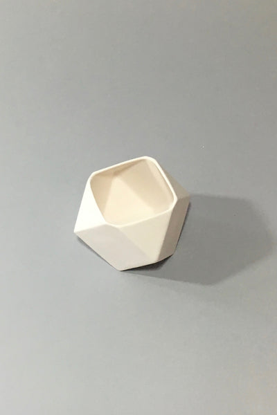 The Granite, white ceramic polyhedron votive, inside