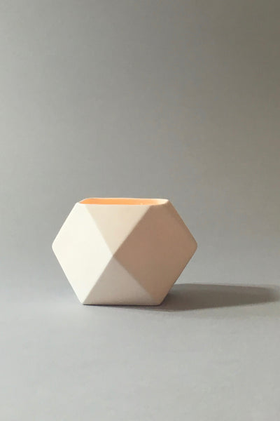 The Granite, white ceramic polyhedron votive, glowing