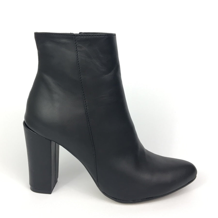 Black ankle boots made from grain real leather