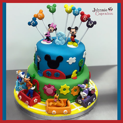 Disney 2 tier cake - Johnnie Cupcakes