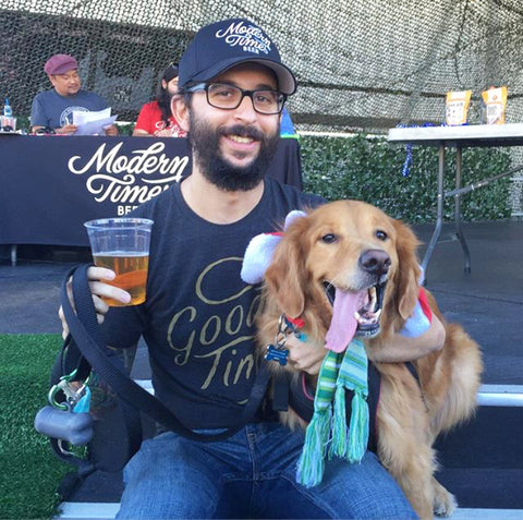 Lead Brewer of Modern Times, Keith Shaw, with his pup Portland.