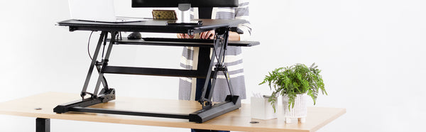 Electric Standing Desk vs. Standing Desk Riser - Which One is Right for You?