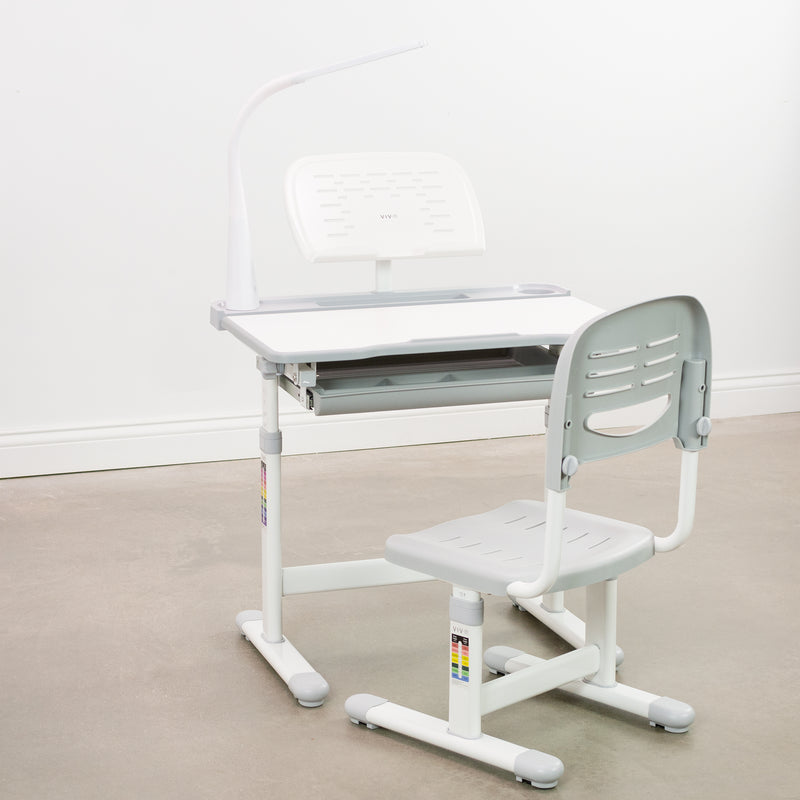 gray and white kids' height adjustable desk with chair