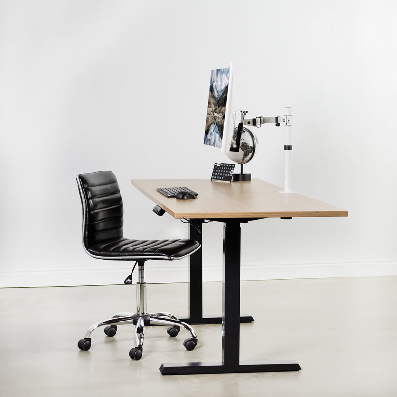 Black Compact height adjustable desk with monitor and black chair