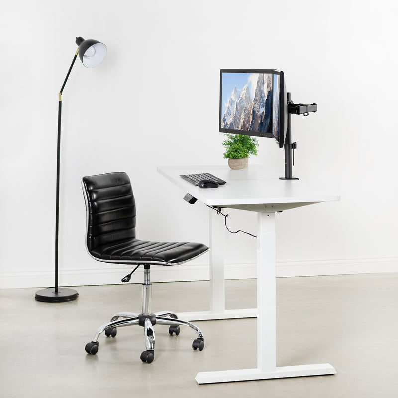 White Compact Electric Desk with black rolling chair and dual monitors