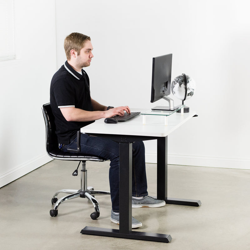 man sitting at White / Black Manual Height Adjustable Desk