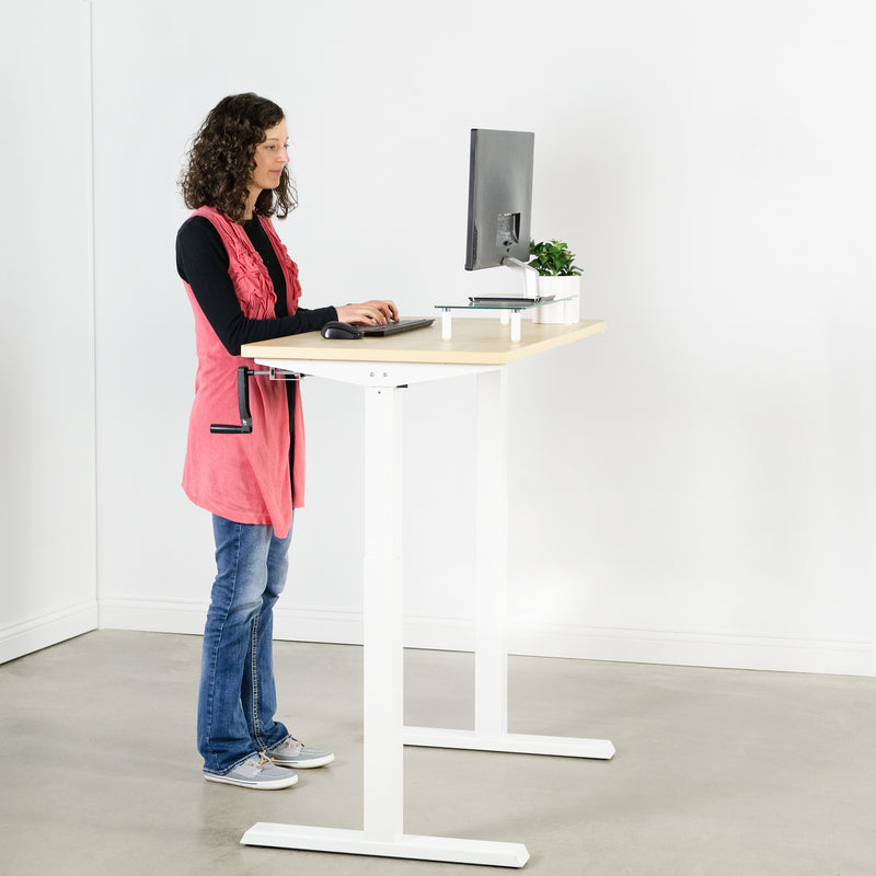 girl typing at Light Wood / White Manual Height Adjustable Desk