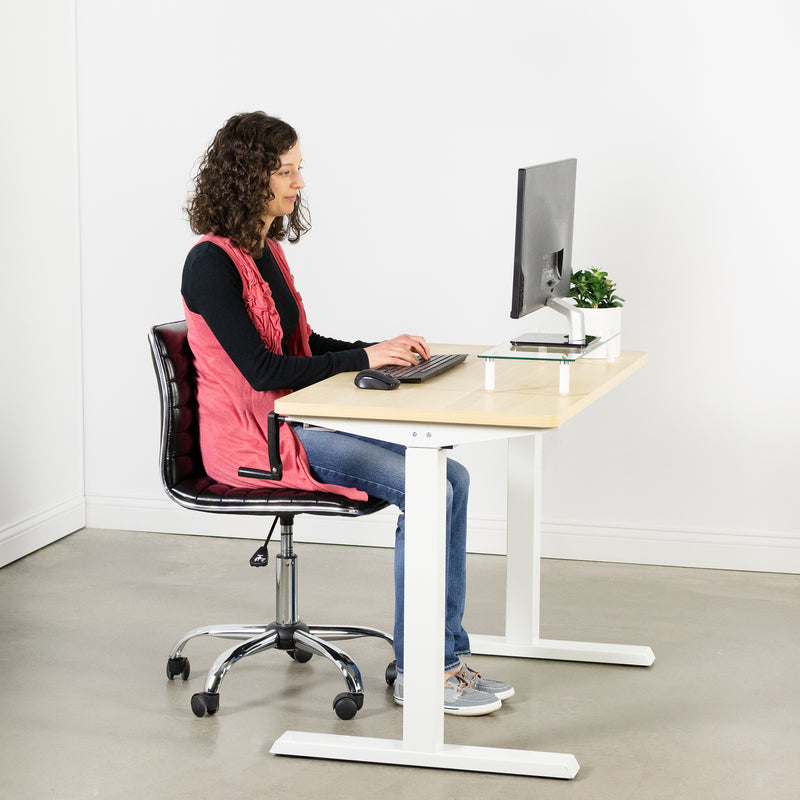 women typing at Light Wood / White Manual Height Adjustable Desk