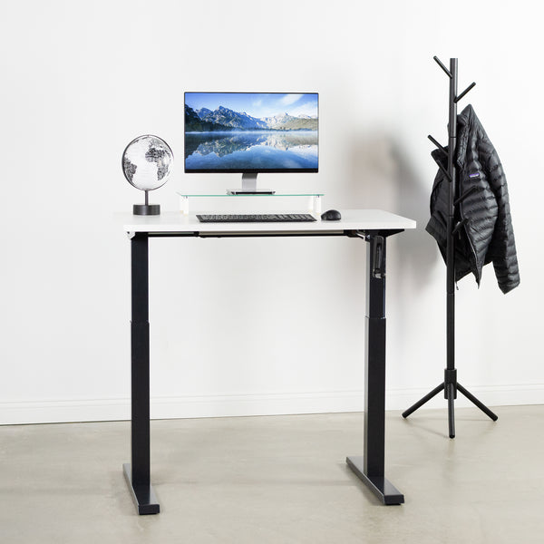 Black Compact Crank Height Adjustable Desk Frame with white top and monitor
