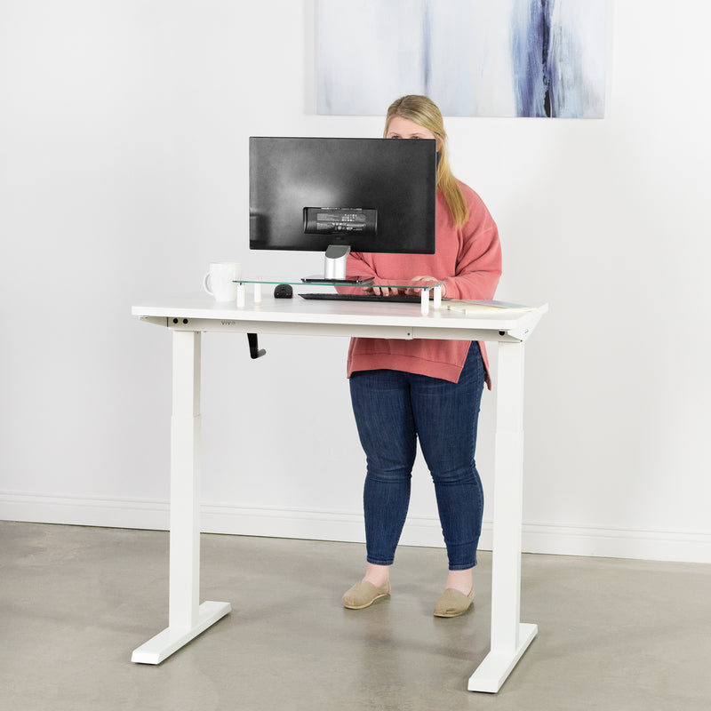 girl typing at White Compact Crank Height Adjustable Desk Frame