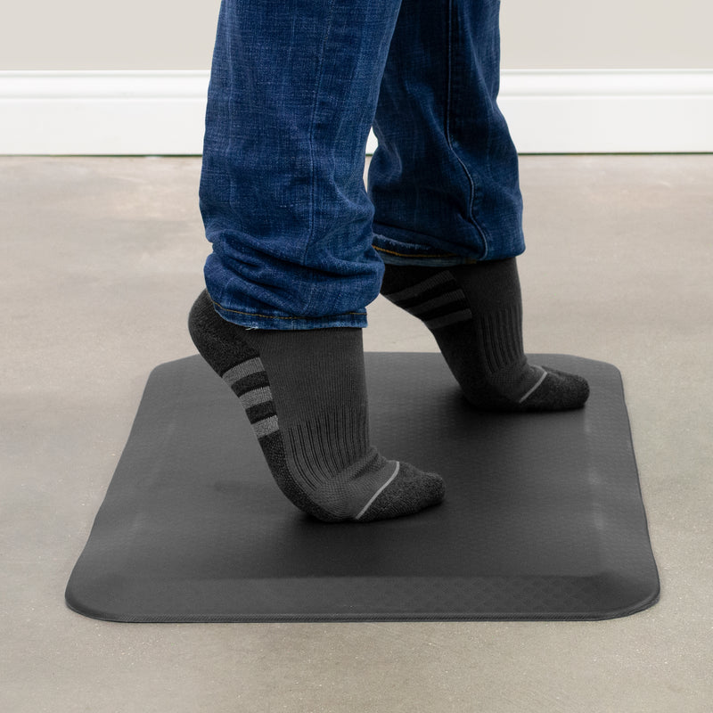 feet standing on Black Foam Anti-Fatigue Mat