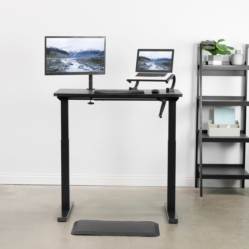 Black Foam Anti-Fatigue Mat and black standing desk with monitor and laptop