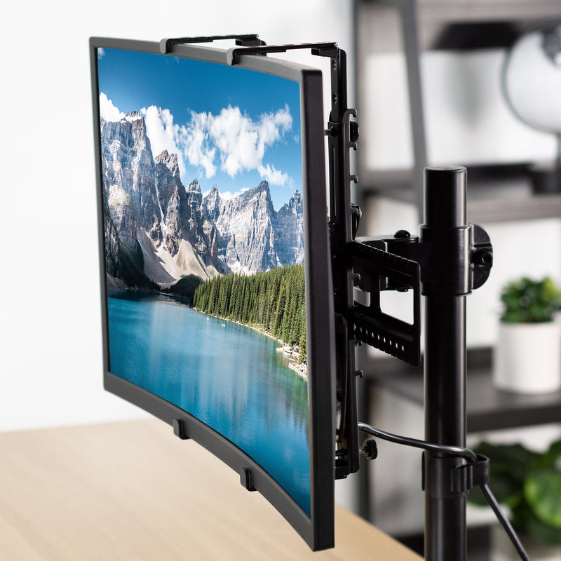 Universal VESA Adapter Bracket holding monitor with mountain landscape