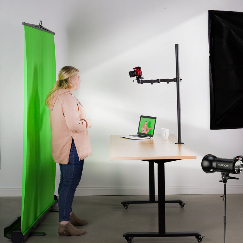 Universal Camera VESA Adapter with girl in front of green screen