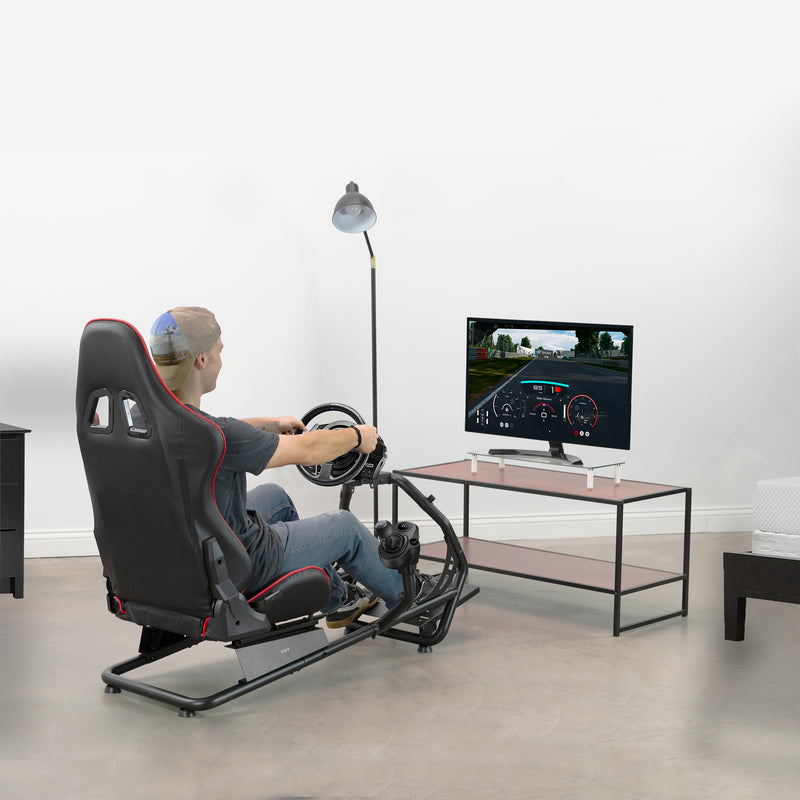 man playing video games in Racing Simulator Cockpit