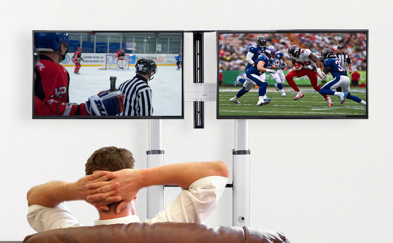 man watching football on Silver Mobile TV Cart