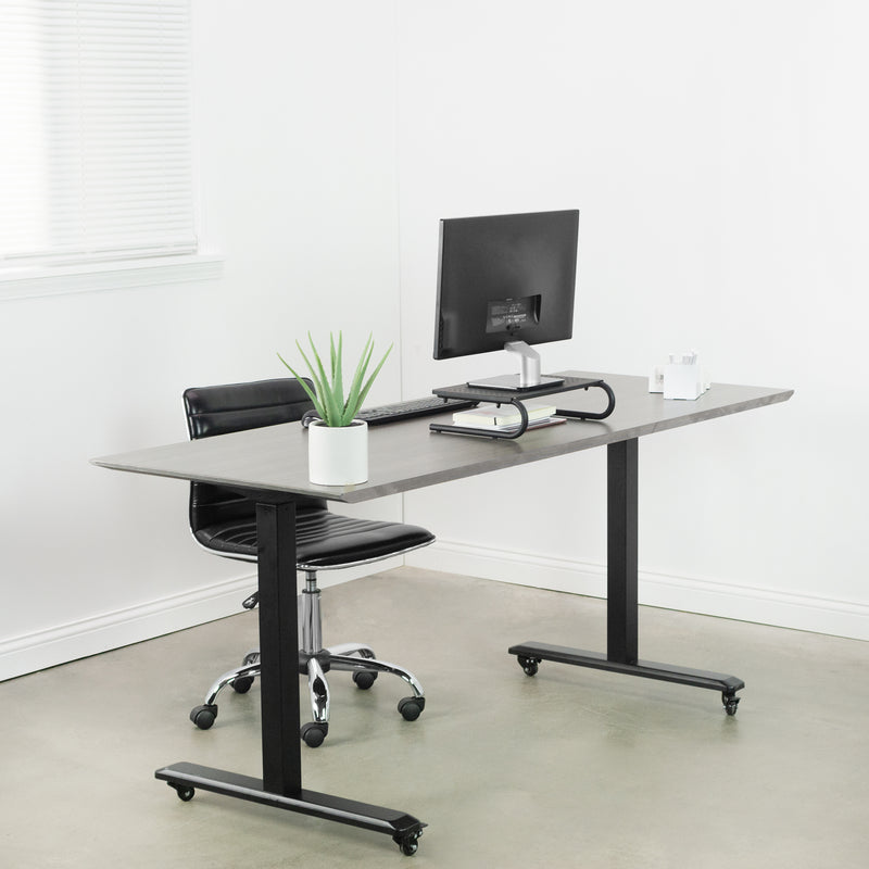 "15"" Vented Monitor Riser with plant on desk"