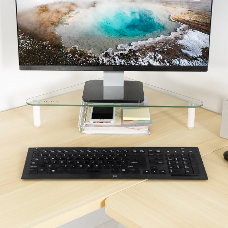 "20"" Triangle Glass Monitor Riser with notebook and phone underneath"
