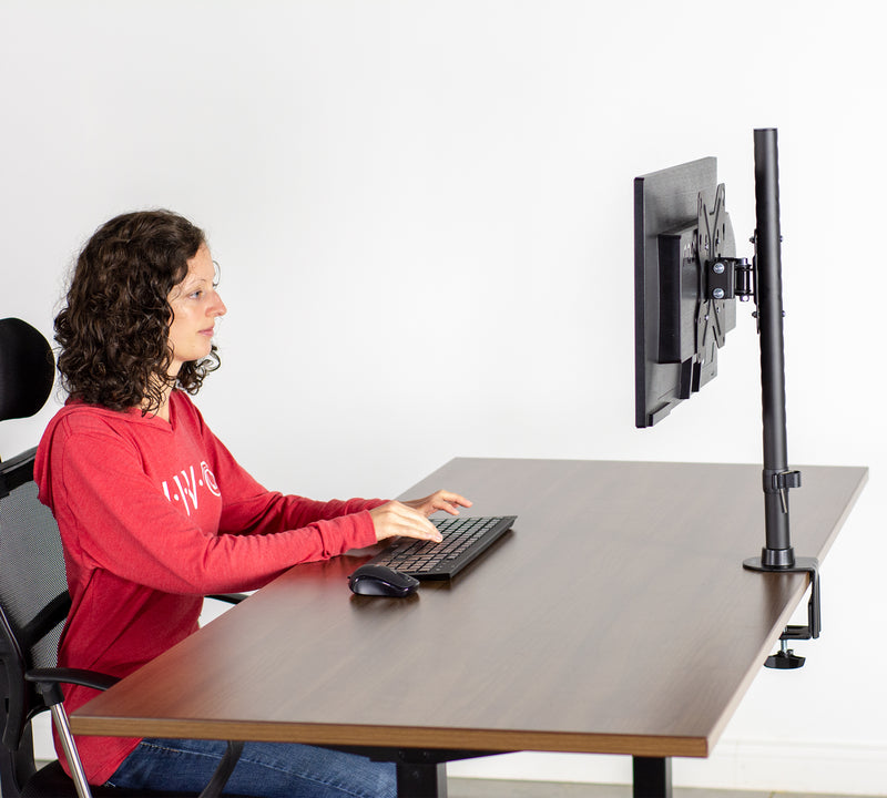 girl sitting at desk with Single Wide Screen TV Desk Mount