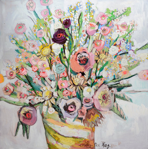 A glorious profession of pink, lavender, light blues, soft yellow flowers in a yellow and white striped pot by Emily Fox King.