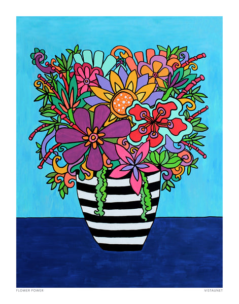 black and white striped vase filled with colorful flowers in bright pinks, purples, oranges, and greens against a turquoise background and a dark blue table.