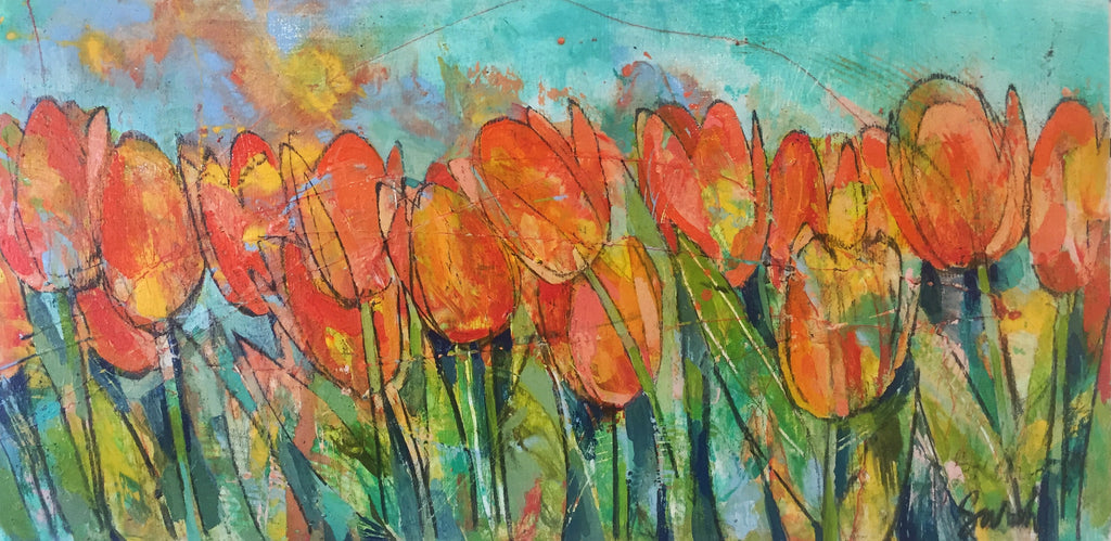 Orange and yellow tulips against a bright turquoise sky.