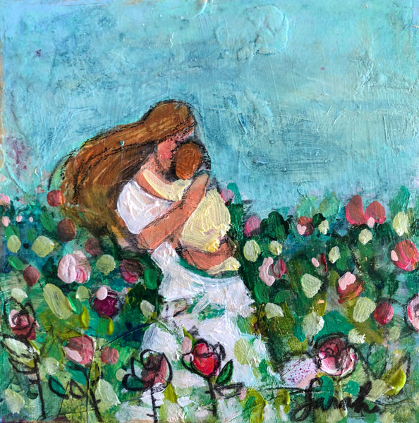 Mother in a white dress holding a baby in yellow in a file of flowers of red, pink, and yellow with a turquoise blue sky.