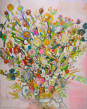 A profusion of multi colored blossoms of every variety gathered in a bow against a pink background