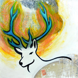 The head of a white deer with blue antlers surrounded with oranges and yellow looks out at you.