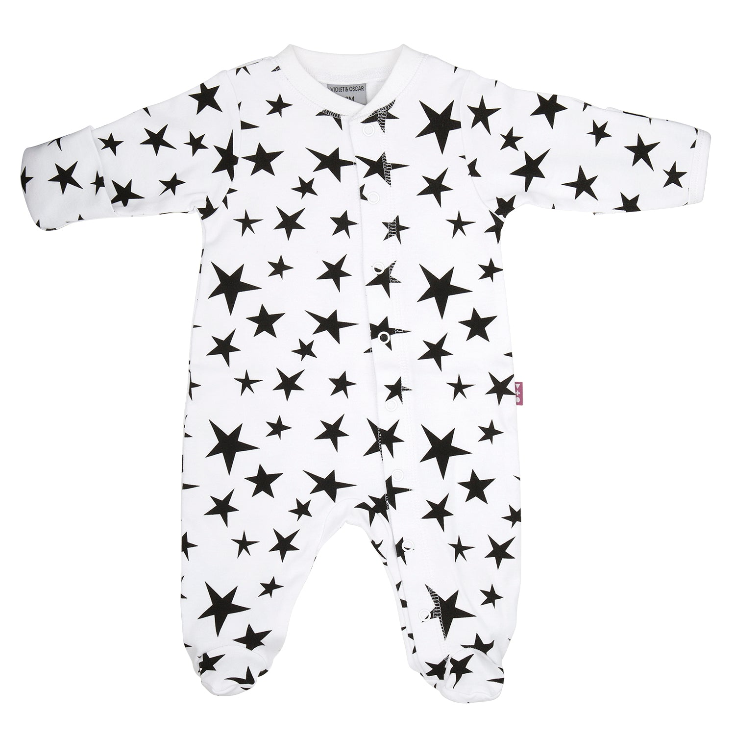 front side of a 100% cotton footed and fitted sleepsuit for baby's with a bright black star print