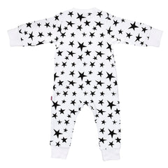 back side of a white 100% cotton sleepsuit for baby with bright black stars