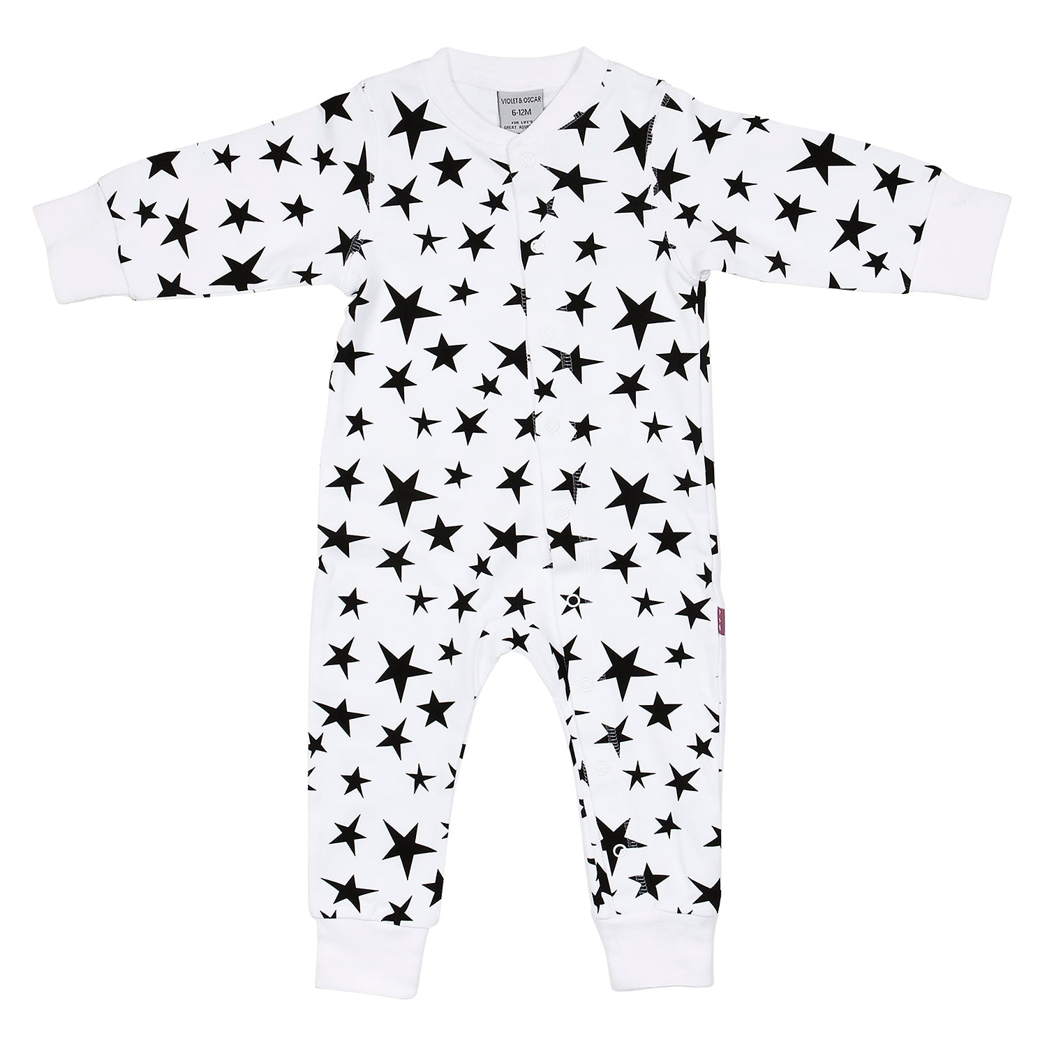front side of a white 100% cotton sleepsuit for baby's with a bright black star print